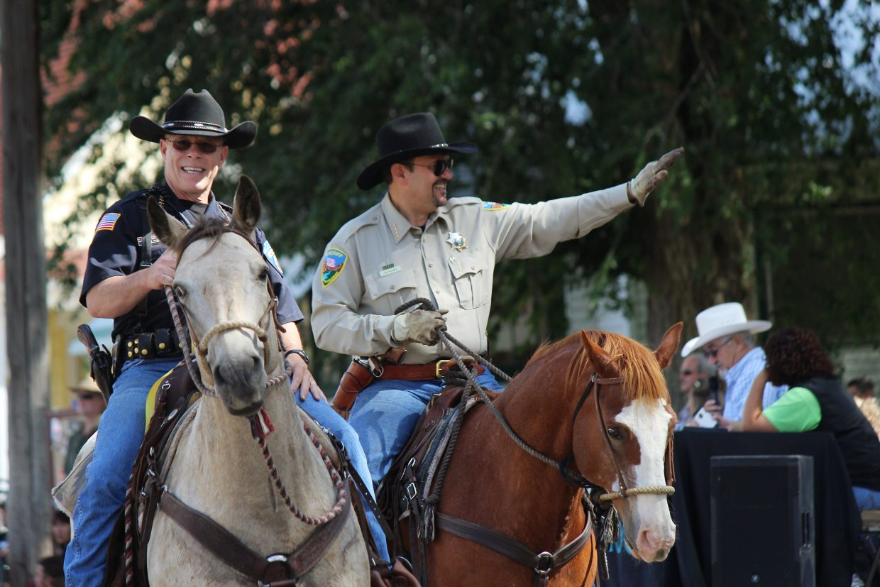 Rifle Police Chief John Dyer, left, and Garfield County Sheriff Lou Vallario ride in the parade at the 2016 Garfield County Fair and Rodeo in Rifle.