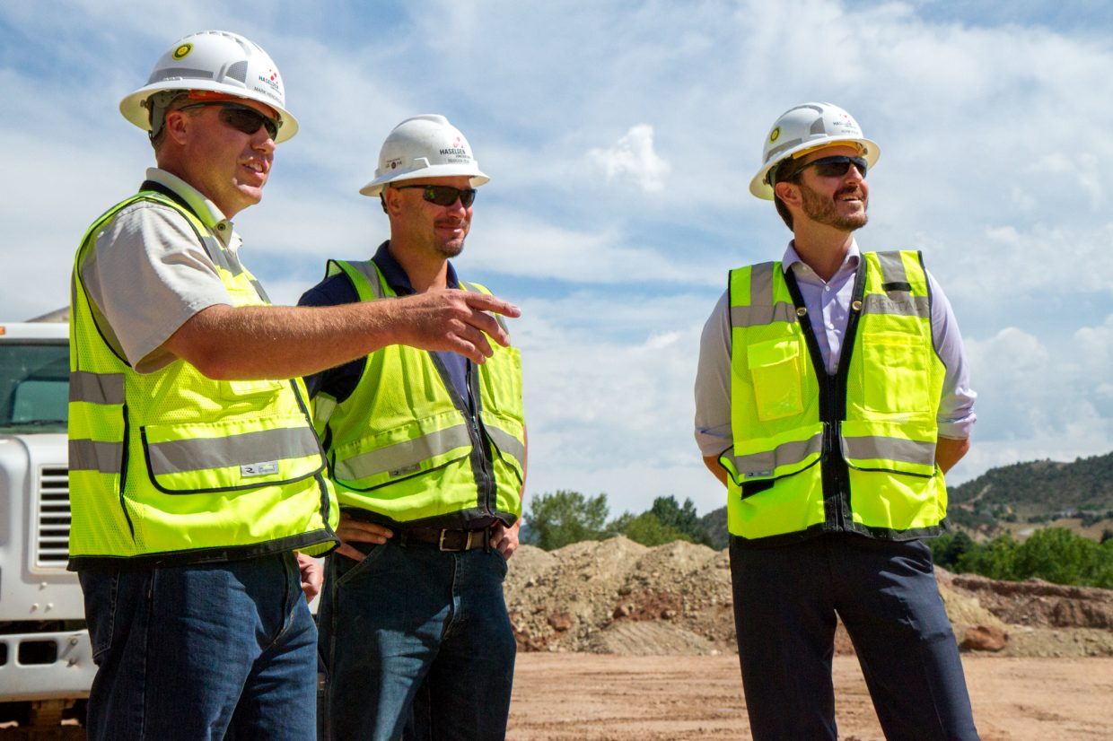 Eastbank pre-K-8 school Principal Adam Volek, right, hears from Project Manager Mark Dendrickson, left, and Haselden Construction Superintendent Brandon Hern about what is currently taking place at the construction site south of Glenwood Springs where the new school is being built.