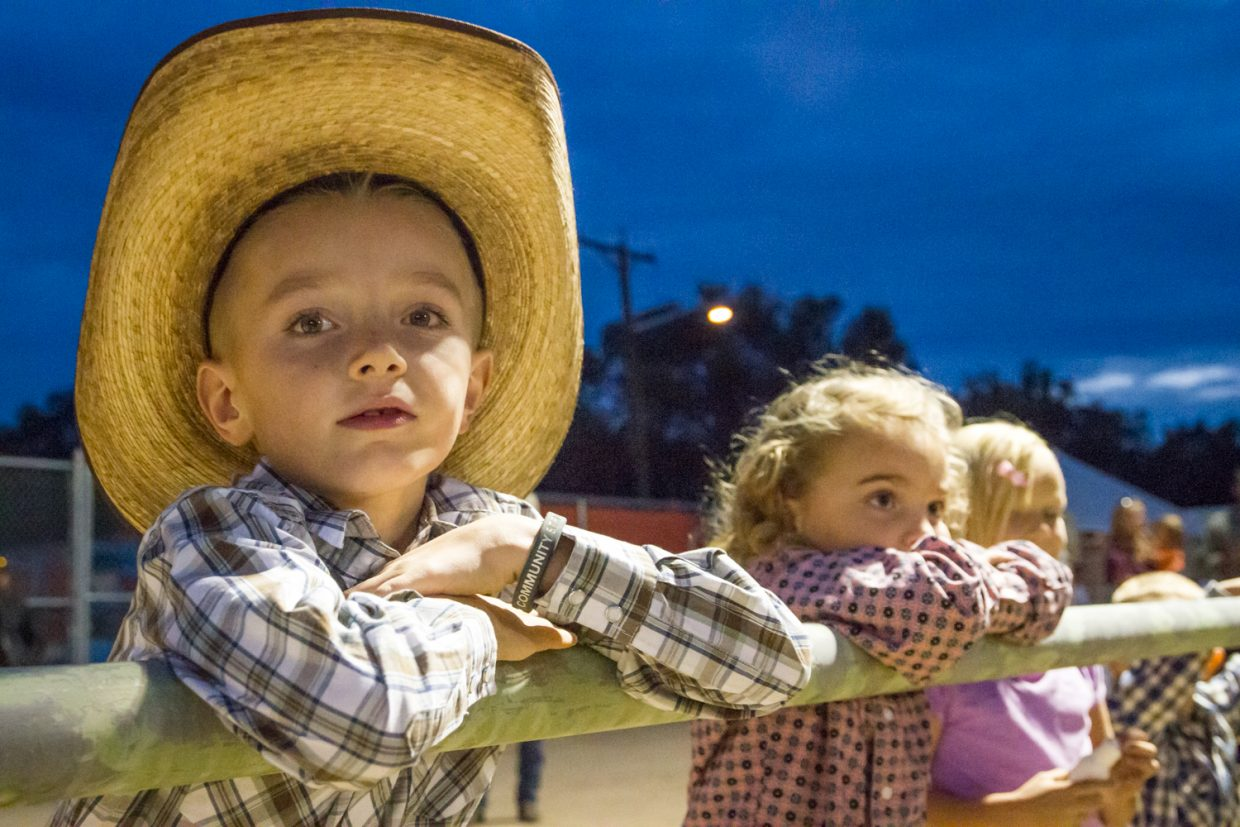Seven-year old Deakon Parchman from Parachute spent the evening at the Garfield County Fair and Rodeo Thursday night— watching cowboys ride the bucking broncos and many other wild events. The fair continues through this weekend at the Garfield County Fairgrounds. For more information and a list of upcoming events go to garfieldcountyfair.com.