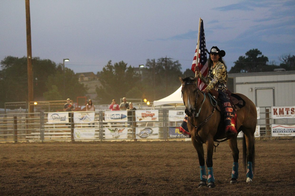 Riley Triebel, the 2016 Garfield County Fair and Rodeo princess, holds an American flag during family rodeo night at the 2016 Garfield County Fair and Rodeo in Rifle Monday.