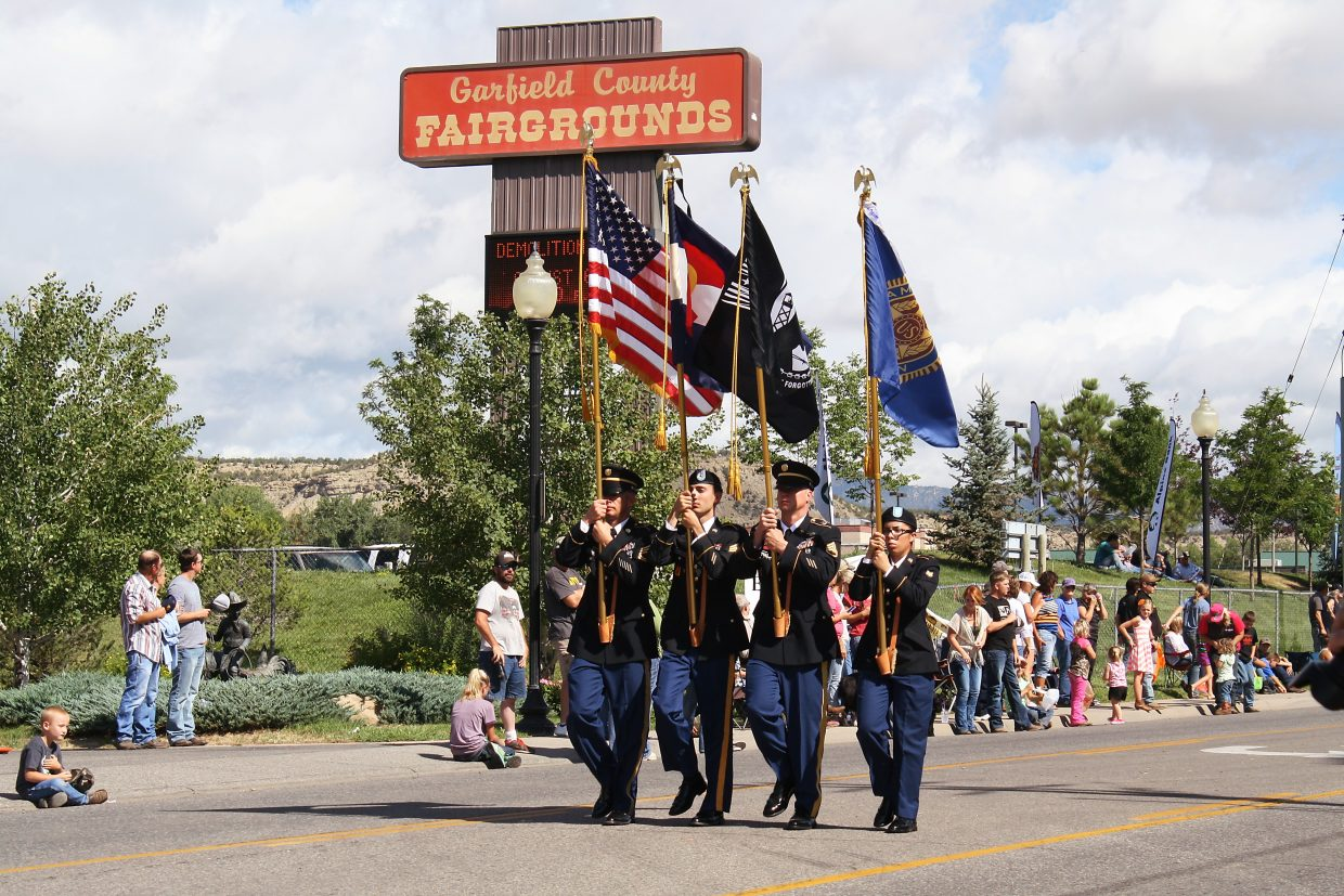 The color guard marches down Railroad Avenue Saturday.