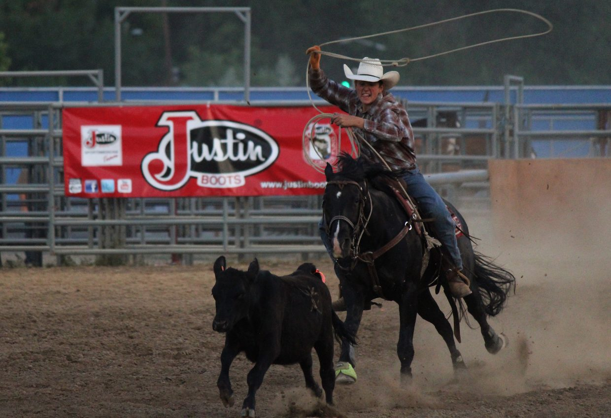 Gus Carney attempts to lasso a calf during family rodeo night at the 2016 Garfield County Fair and Rodeo in Rifle Monday.