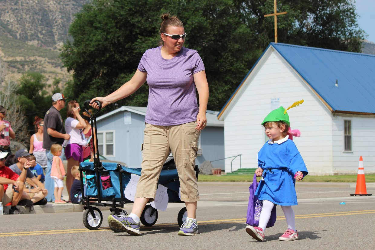 CJ Richards and her mother, Dusty, walk in the Grand Valley Days parade.