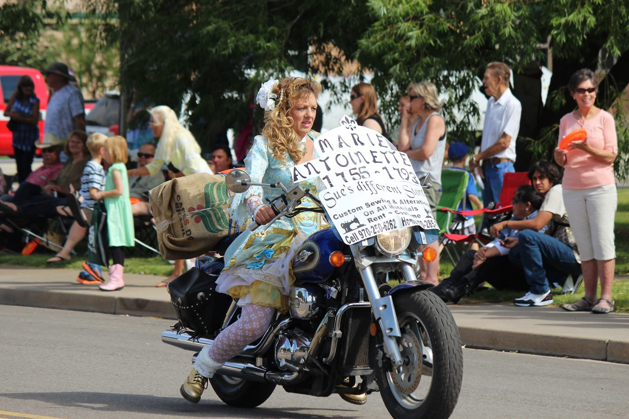 Dressed as Marie Antoinette, Sue Rill rides her motorcycle in the Grand Valley Days parade.