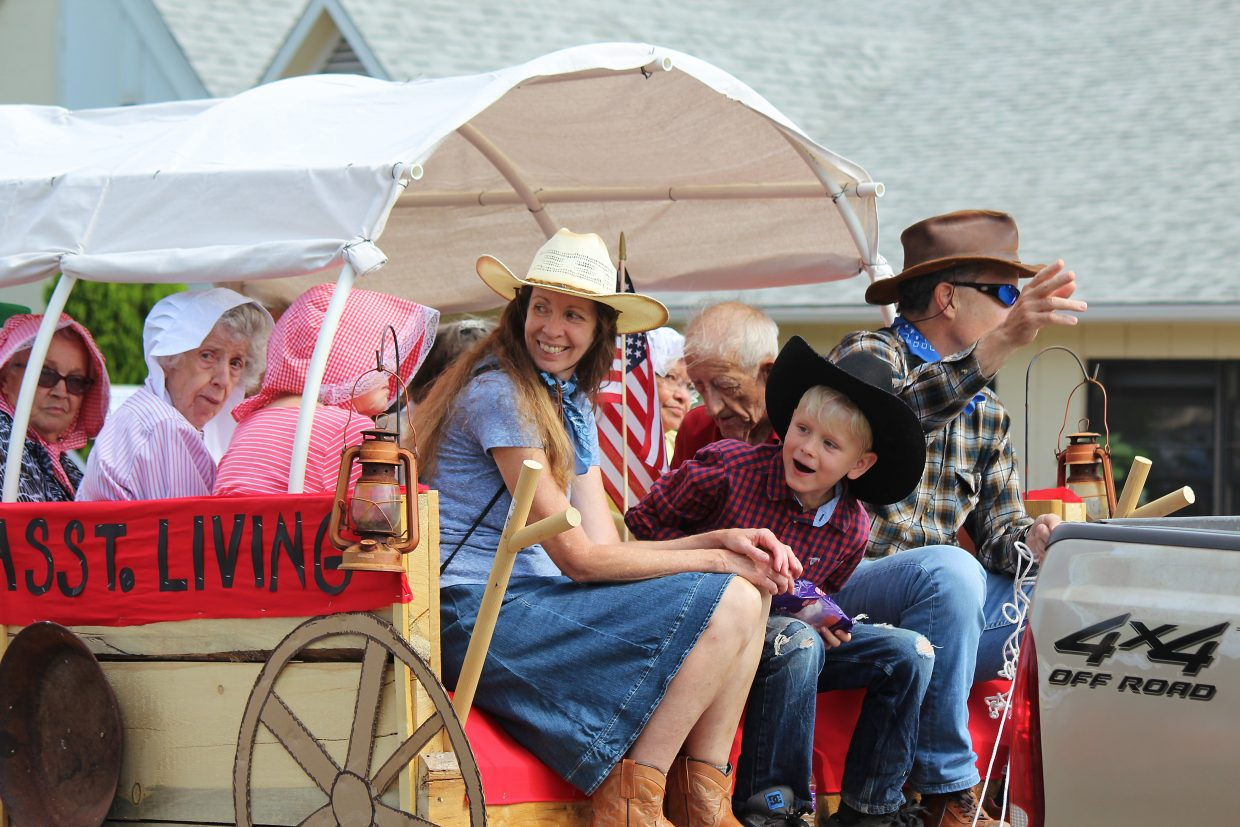 The folks from Mesa Vista Assisted Living in Battlement Mesa waive to the crowd in the Grand Valley Days parade.