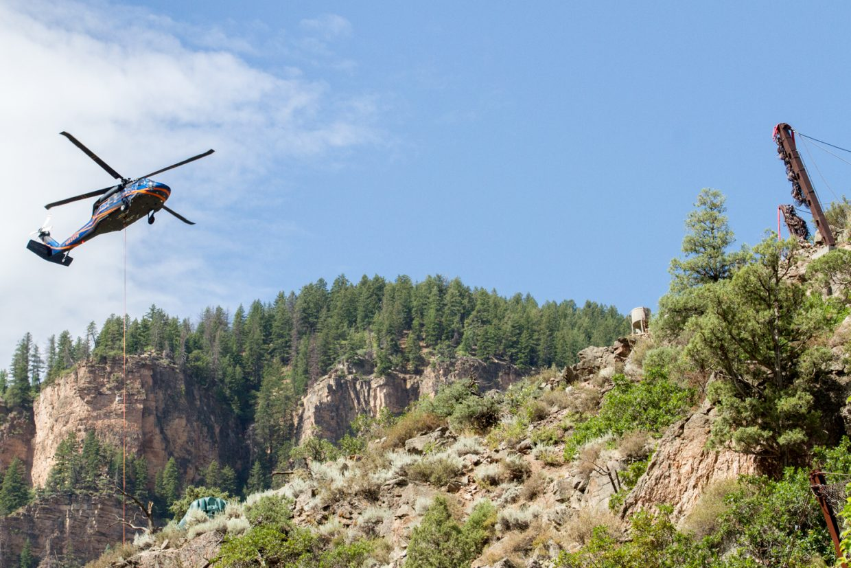 A blackhawk helicopter from Idaho was utilized Wednesday morning in Glenwood Canyon to lift steel beams and fencing to crews high on the slope.