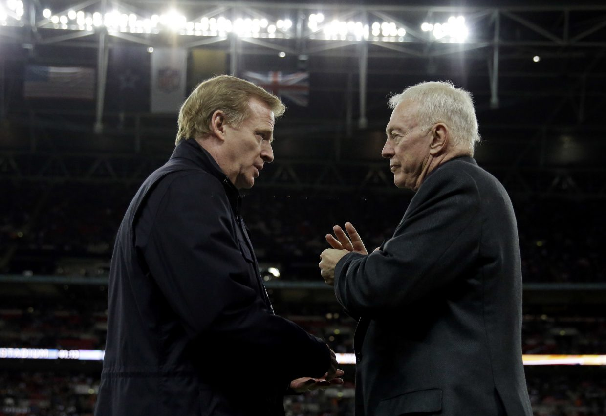 "FILE - In this Nov. 9, 2014, file photo, NFL commissioner Roger Goodell, left, and Dallas Cowboys owner Jerry Jones talk during an NFL football game between the Jacksonville Jaguars and Dallas Cowboys at Wembley Stadium in London. For all of the public (and players' association) angst regarding Goodell, who enters his second decade in charge on Thursday, Sept. 1, 2016, he couldn't be held in higher esteem by most of the 32 team owners _ his bosses. ""I know how passionate he is about the game, how committed he is,"" Cowboys owner Jerry Jones says.  (AP Photo/Matt Dunham, File)"
