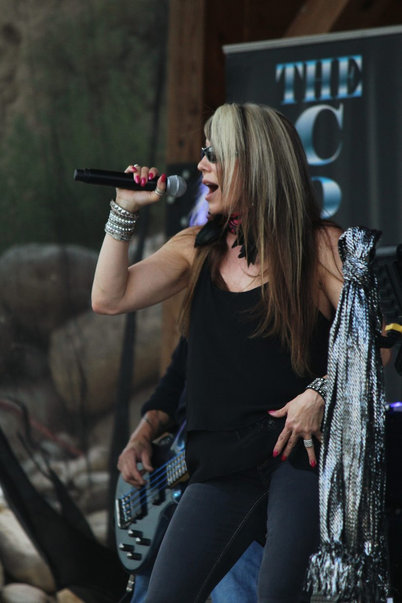 Danna Campbell, of the Sisters of Rock, performs with the Corporation Band Friday.