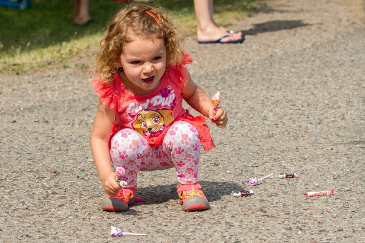 Two-year old Harper Stepisnik was beyond excited to get as much candy as possible during the Silt Heydays parade Saturday morning.