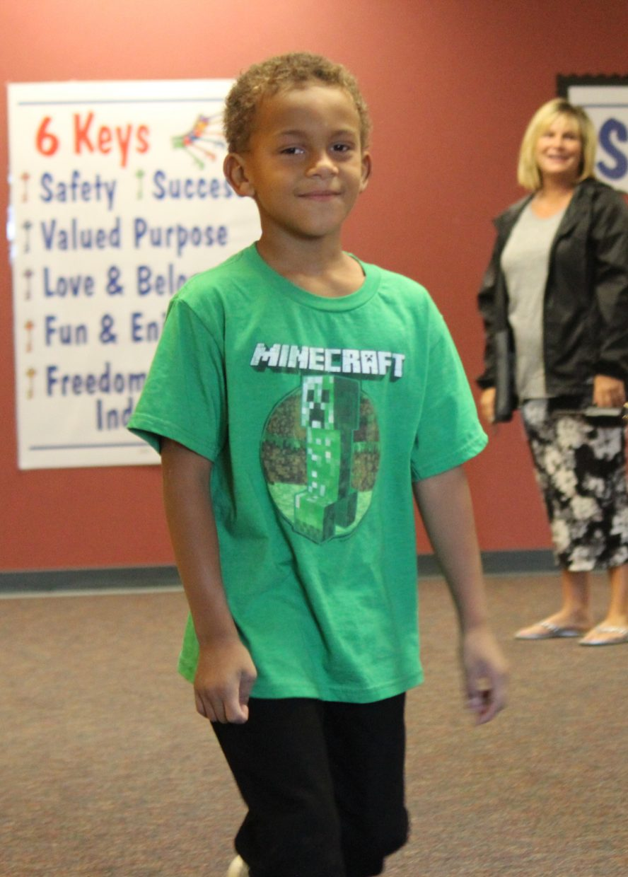 Second-grade student Davin Mwamba flashes a grin before heading outside at Graham Mesa Elementary School Monday.