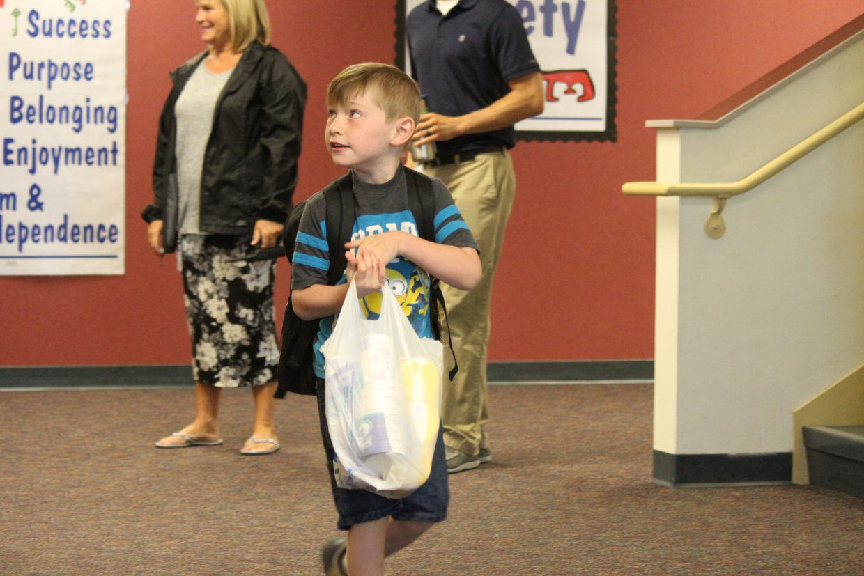 Steven Wilson eagerly walks into Graham Mesa Elementary School Monday for his first day of kindergarten.