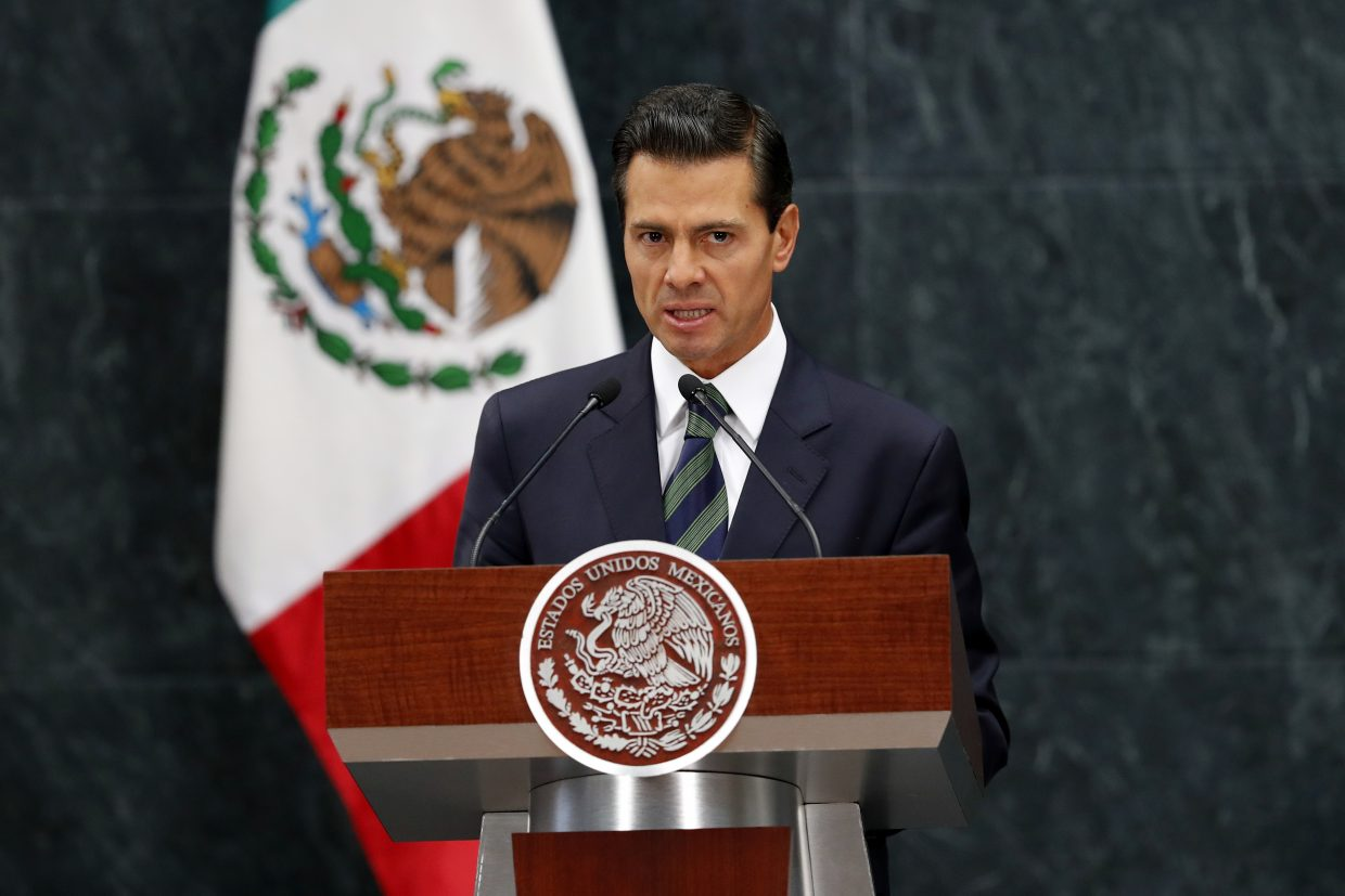 Mexico's President Enrique Pena Nieto speaks during a a joint statement with Republican presidential nominee Donald Trump in Mexico City, Wednesday, Aug. 31, 2016. Trump is calling his surprise visit to Mexico City Wednesday a 'great honor.' The Republican presidential nominee said after meeting with Peña Nieto that the pair had a substantive, direct and constructive exchange of ideas.(AP Photo/Dario Lopez-Mills)