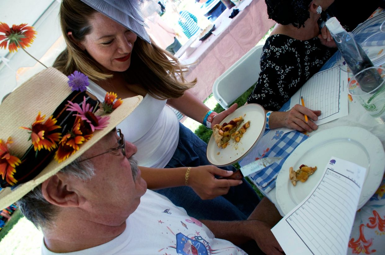 Frank Norwood gets ready to taste a piece of pie, served by Carly Debeque, at the pie baking contest during a past Fair.