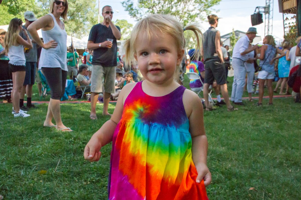 Two-year old Chloe Kuhner dancing while the band Sneaky Pete and the Secret Weapons plays.