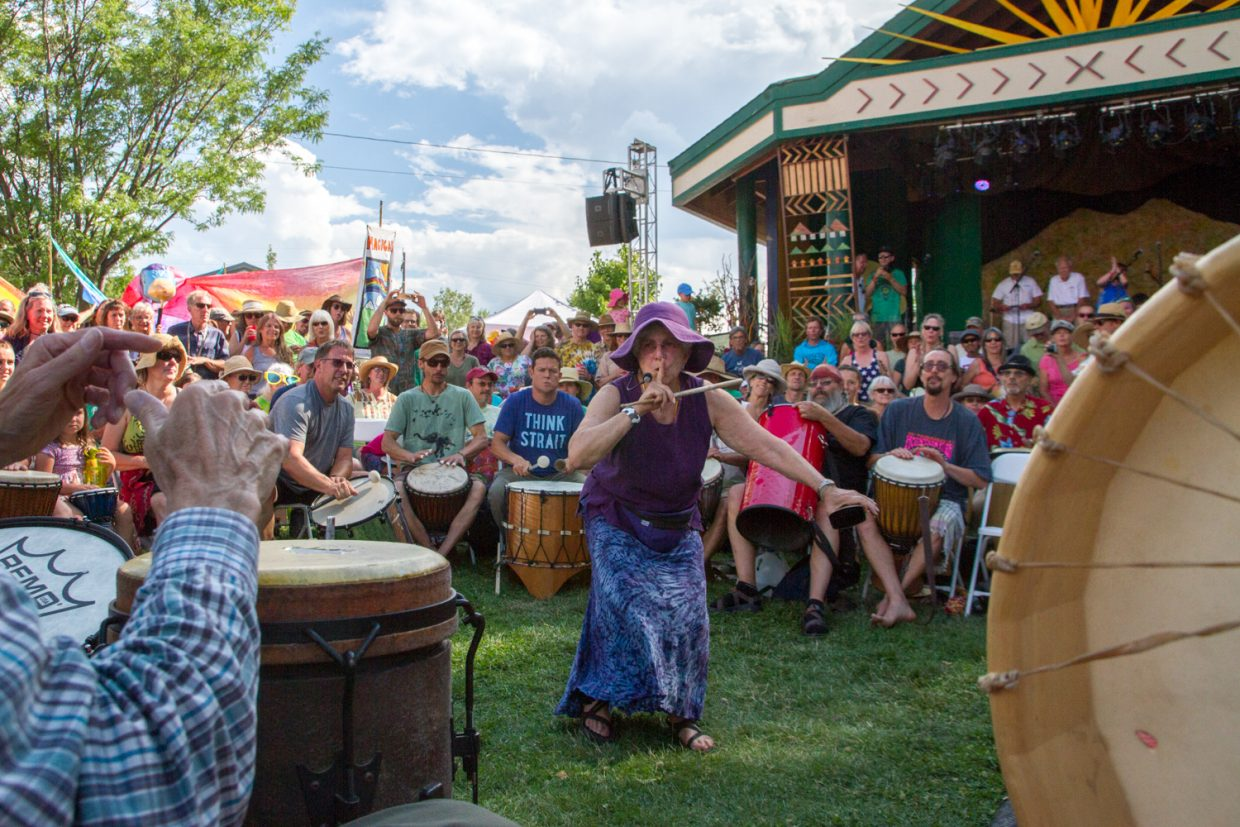 Laurie Loeb leading the roughly 300 members of the Rhythms of the Heart Community Drum Circle during the first night of the 45th Annual Carbondale Mountain Fair.