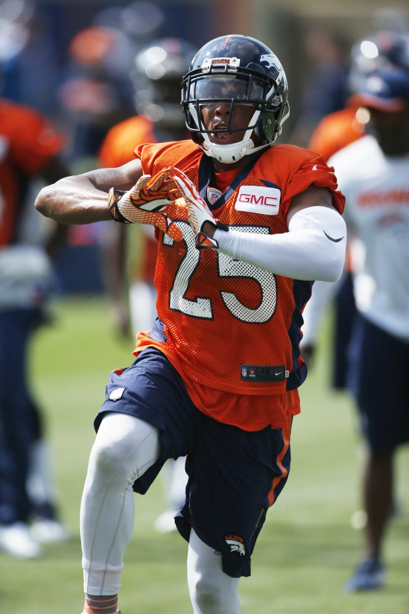 Denver Broncos cornerback Chris Harris takes part in drills during the team's NFL football training camp Friday, July 29, 2016 in Englewood, Colo. (AP Photo/David Zalubowski)