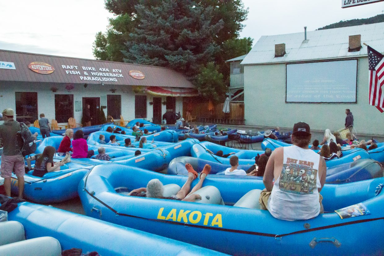 Visitors and locals are invited to kick back and enjoy a free movie using the rafts and duckies as lounge chairs.