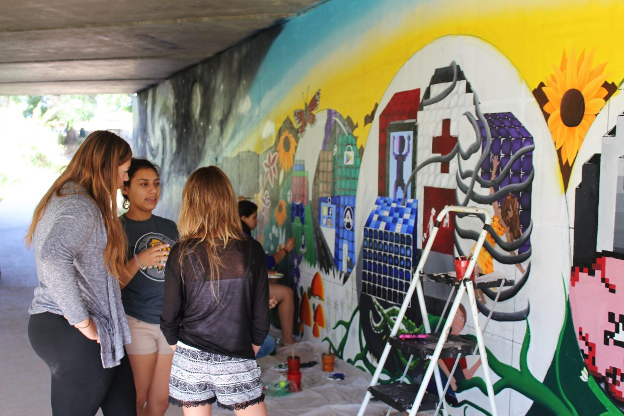 Teenage artists from area high schools discuss a potential name for a mural along the Rifle Creek Trail underpass near 16th Street.