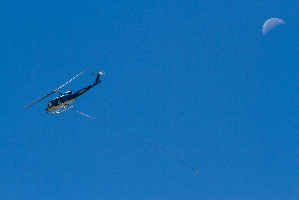 A Huey helicopter was utilized to lift steel posts, weighing 1,800 to 2,800 pounds each.