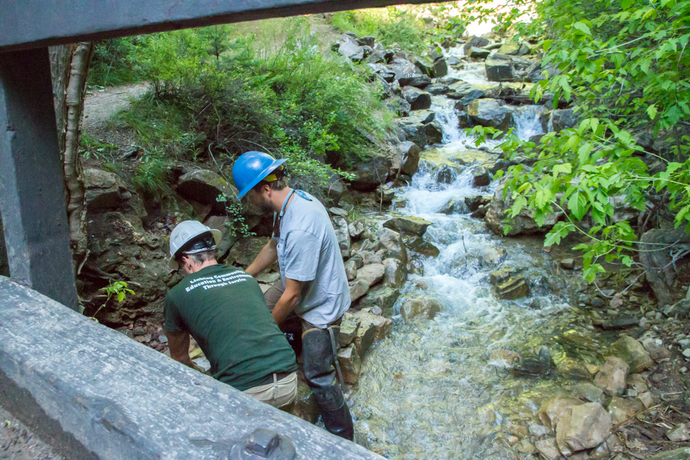 Brian Roders (left) and Adam Joret with the US Forrest Service using rocks to create an embankment along the Hanging Lake trail.
