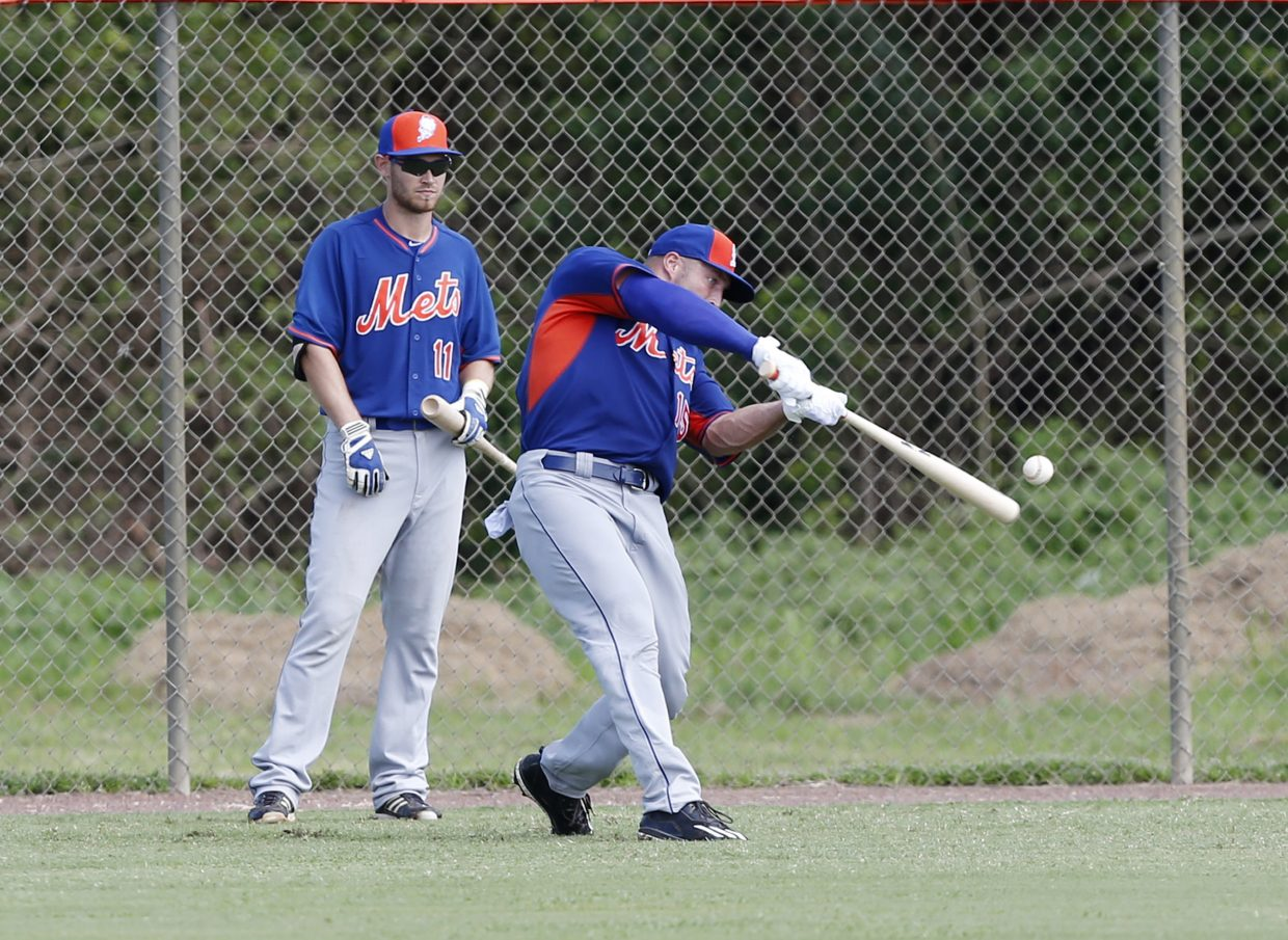 Tim Tebow, right, bats as Patrick Mazeika (11) waits his turn at the New York Mets' complex, Monday, Sept. 19, 2016, in Port St. Lucie, Fla. The 2007 Heisman Trophy winner and former NFL quarterback got to the complex early Monday, and started his first workout as part of their instructional league team. (AP Photo/Wilfredo Lee)