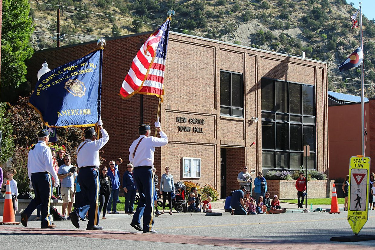Members of the American Legion Post 164 color guard march down Main Street during the annual Burning Mountain Festival in New Castle.