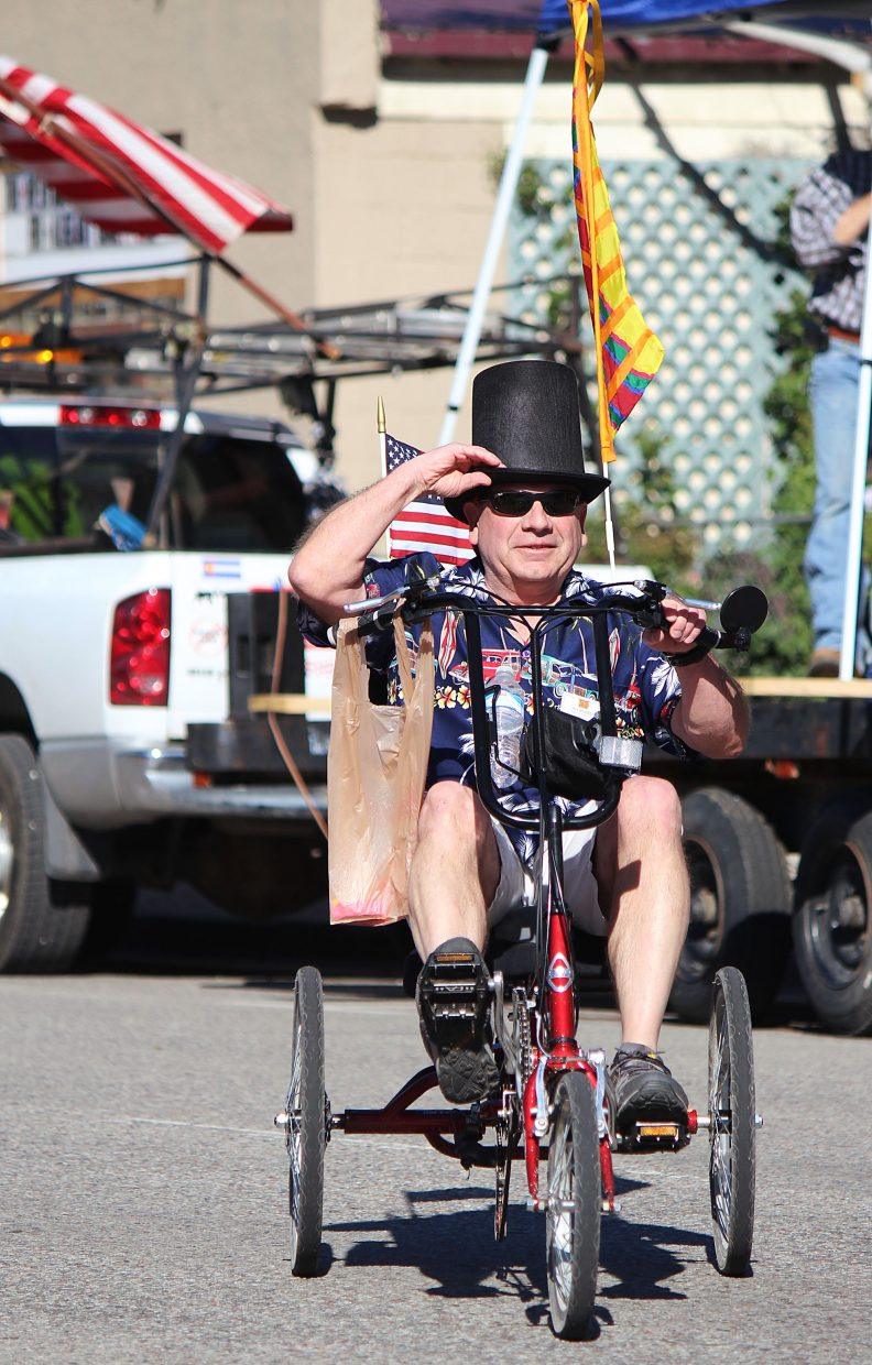 New Castle Mayor Art Riddile pedals down Main Street.