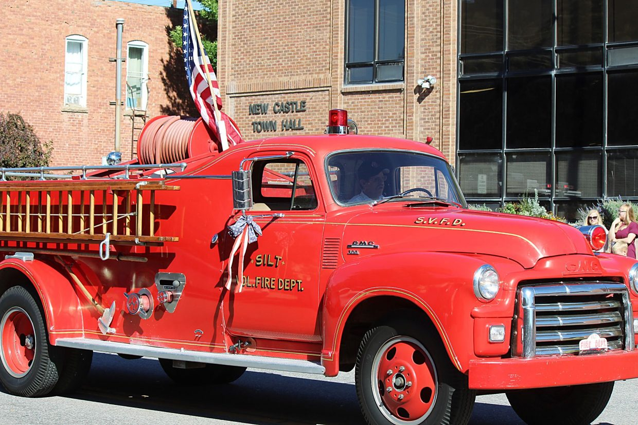 Orrin Moon, Colorado River Fire Rescue fire marshal, drives an old Silt Volunteer Fire Department truck.