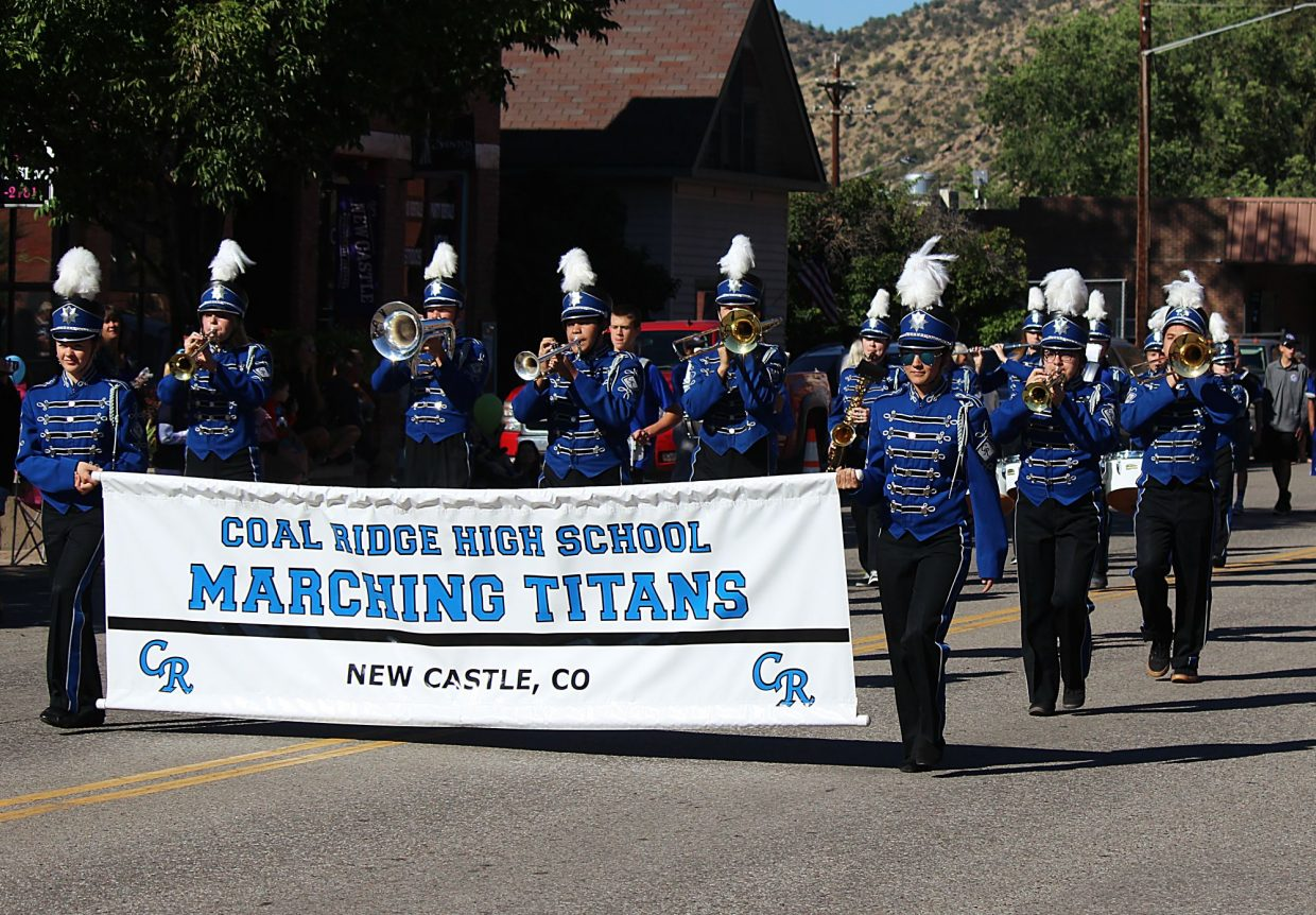 The Coal Ridge High School marching band makes its way down Main Street.