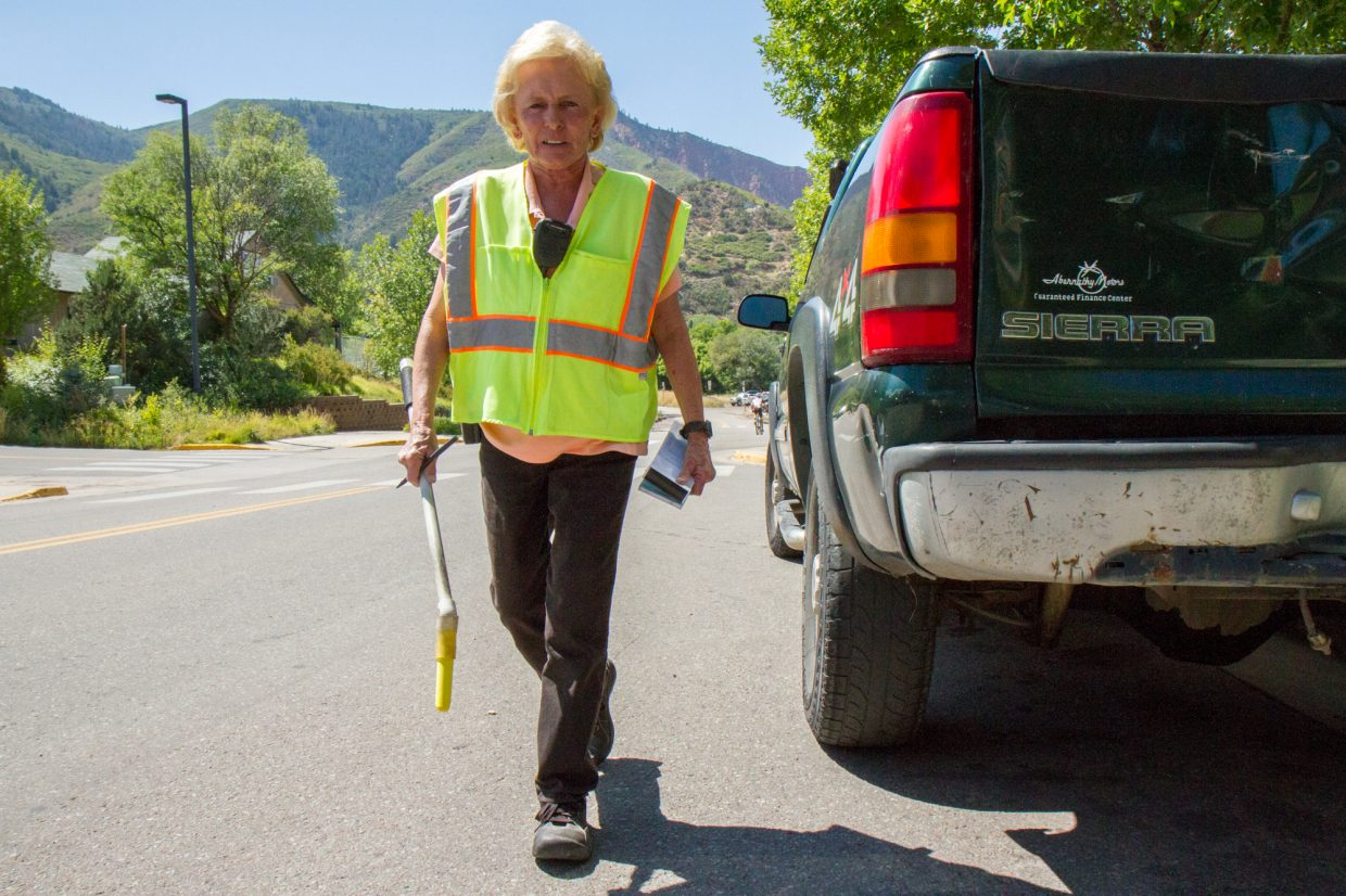 Glenwood Springs Parking Enforcement Officer Janie Daniels walks an estimated 10 miles a day marking cars and giving tickets for parking violations around downtown Glenwood Springs.