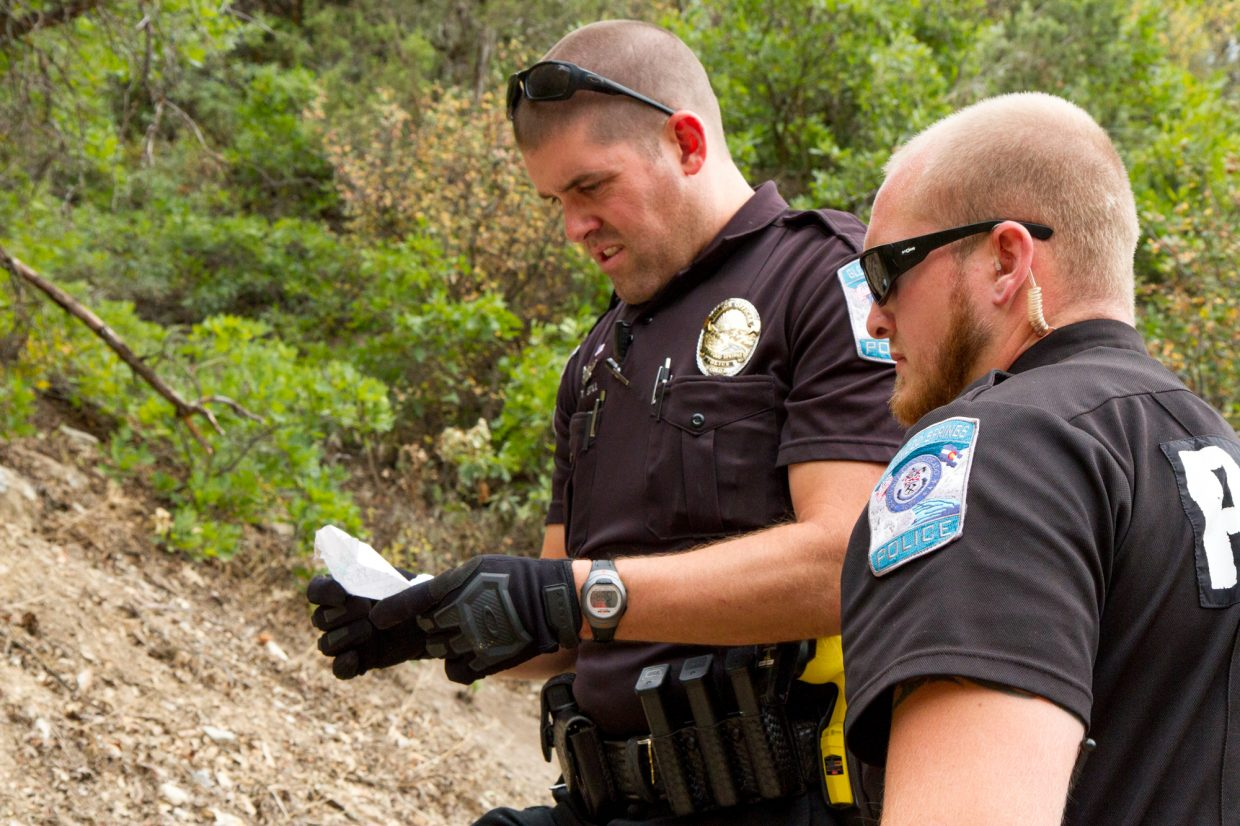 Officers Travis Still and Kris Miller looking for occupants of the homeless camps near Boyscott Trail East of Glenwood Springs.