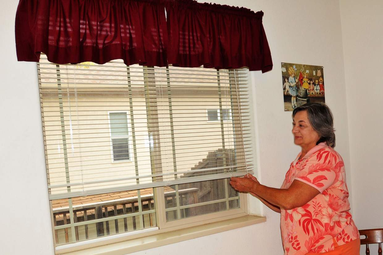 Windows in Margaret McGhee's Battlement Mesa home weren't closing properly. As part of her CARE energy upgrades, Bob Layman of Woodpecker Workshop repaired the windows so they could be closed tight.