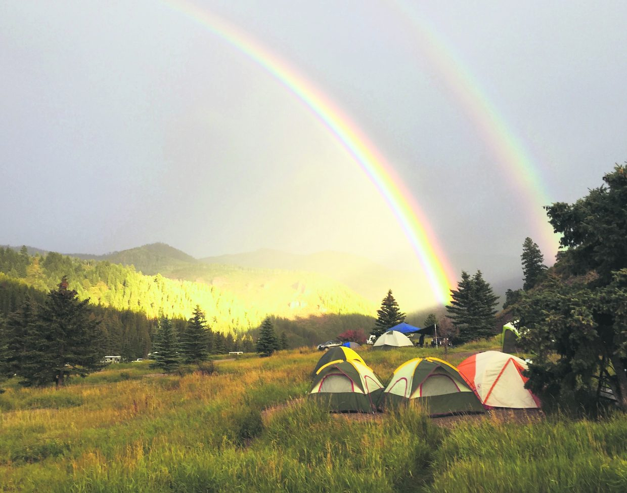 A rare morning double rainbow emerges over the Brush Creek Valley and the Sylvan Lake Campground over Labor Day weekend.
