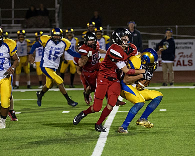 Grand Valley's Jayden Wood makes a big stop behind the line Friday against Roaring Fork's Alex Garcia. (LYNN SHORE)