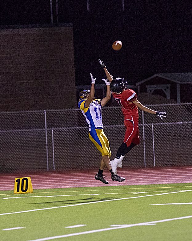 Grand Valley's Angel Garcia breaks up a pass intended for Roaring Fork's Aldo Pinela Friday in Parachute. (LYNN SHORE)