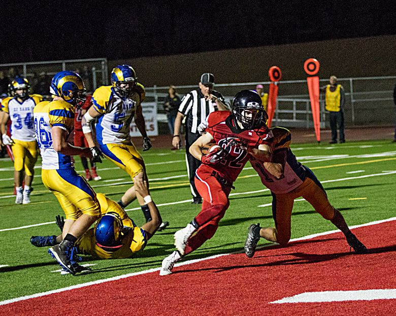 Grand Valley's Jason Schubert powers his way into the end zone Friday for the Cardinals against the Roaring Fork Rams. (LYNN SHORE)