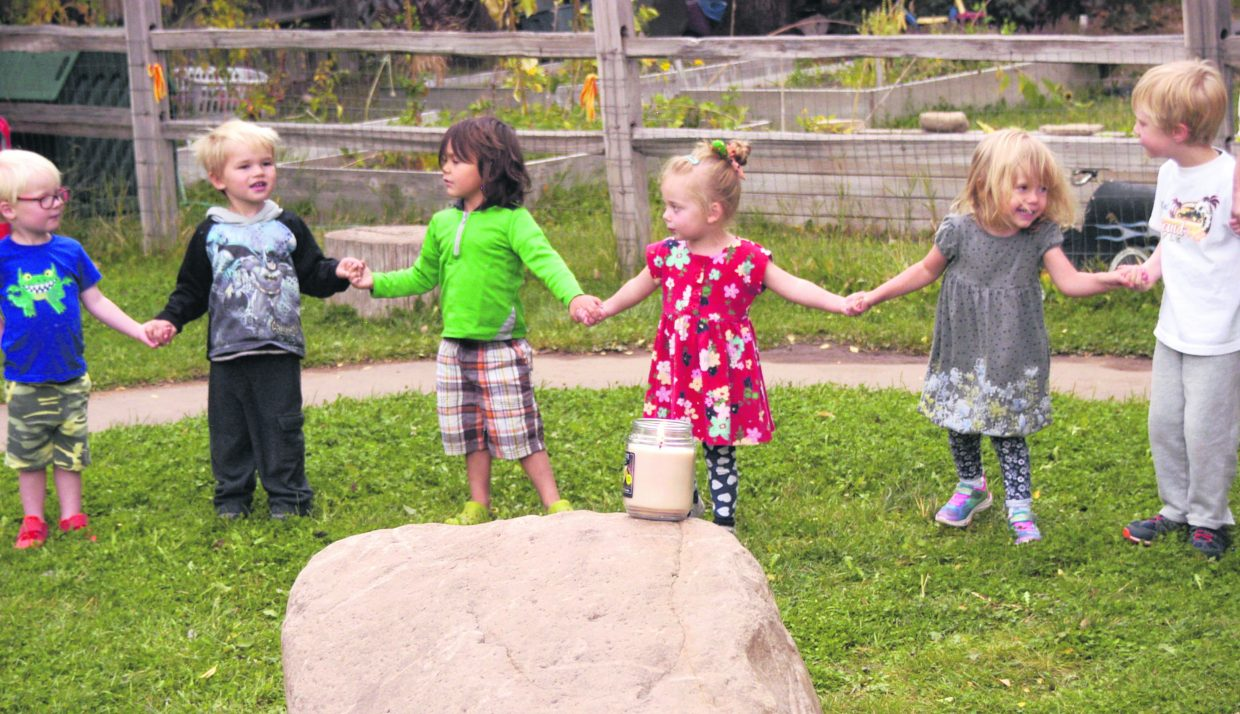 "Mt. Sopris Montessori Preschool students sing ""Light a Candle for Peace"" in Carbondale Wednesday for the United Nations Day of Peace sing around the world.."