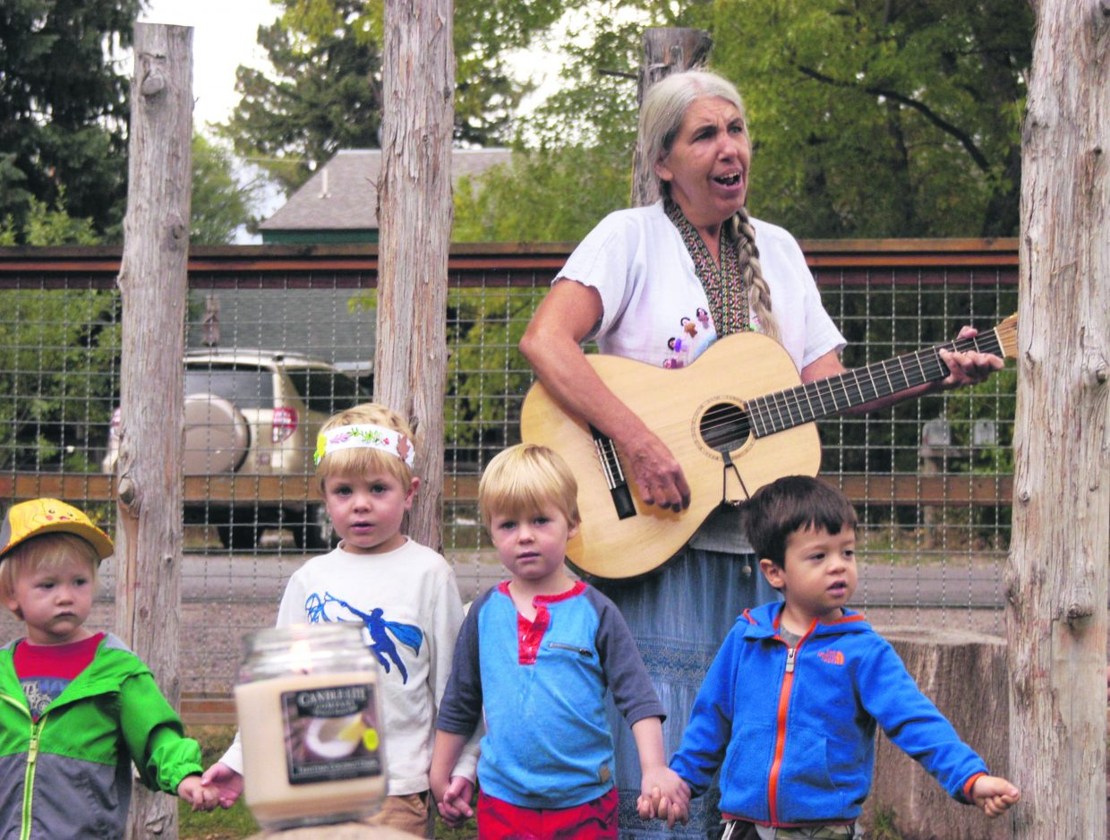 "Mt. Sopris Montessori Preschool teacher Teri McDuffey leads students including, from left, Daxon Berger, Atlin Mason, Tag Speaker and Niko Ritschard, in the song ""Light a Candle for Peace"" in Carbondale Wednesday morning. The global sing-along had groups of Montessori students singing in succession for 24 straight hours starting in Australia and ending in Hawaii as part of the United Nations Day of Peace."