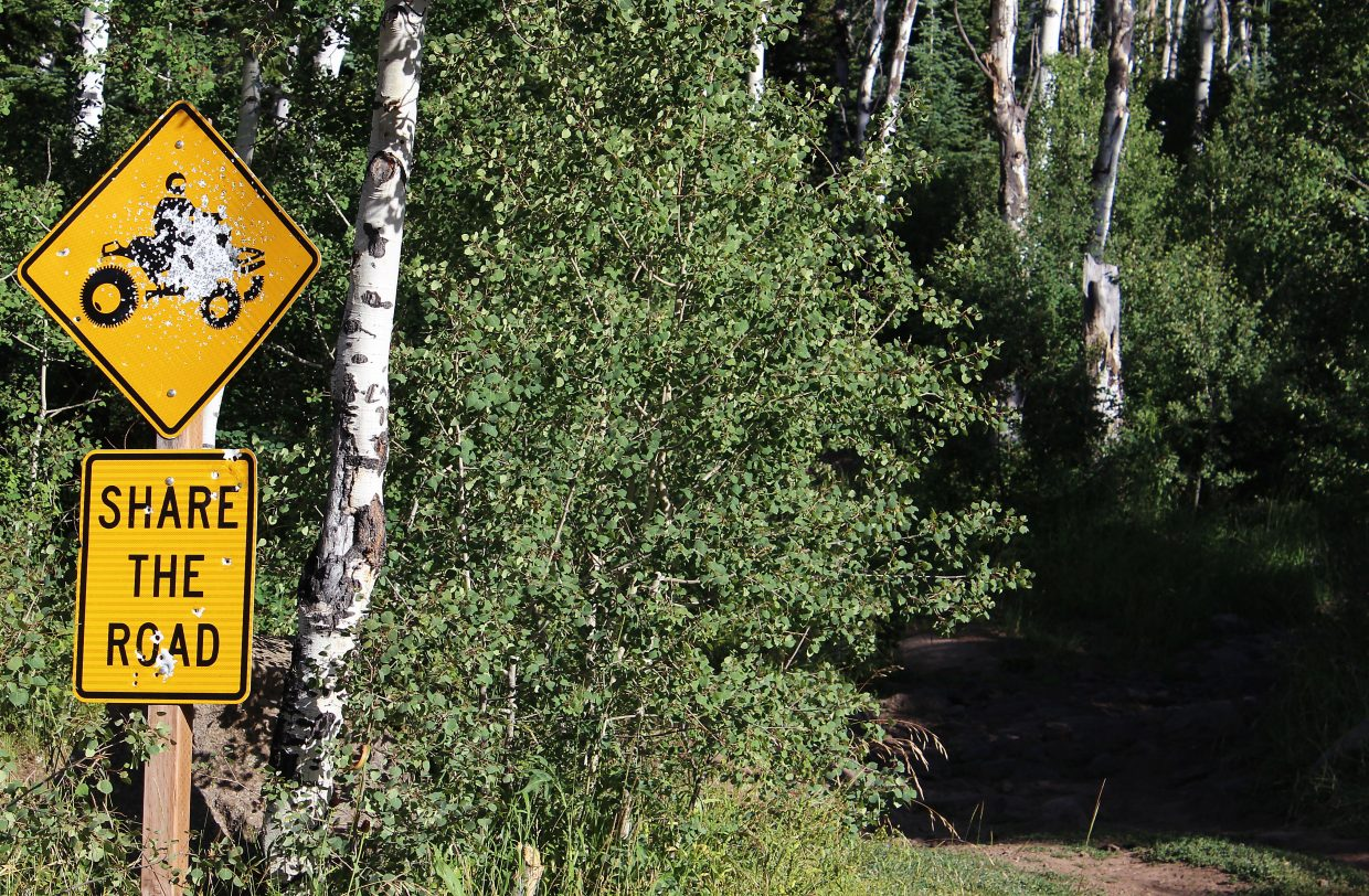 A sign instructs motorists to share the road on a four-wheel drive trail leading up to the Battlement reservoirs in the White River National Forest south of Parachute.