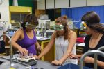 Glenwood High School senior Keyla Contreras, left, and Summit County High School students Lizbeth Serrano and Nancy Higuera, in an advanced chemistry lab at CU Boulder last summer.