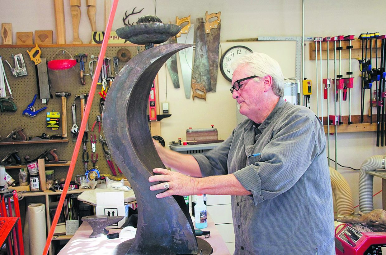 Jim Mason puts the finishing touch on a fire feature.