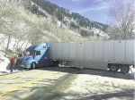 "A semi-truck gets stuck as it tries to turn around near the closure gate on Independence Pass last February. Truckers and other motorists had been heading toward Aspen seeking an alternative route during the Glenwood Canyon closure without realizing the pass is closed during winter months. Police estimate ""hundreds"" of cars and trucks were turned away."