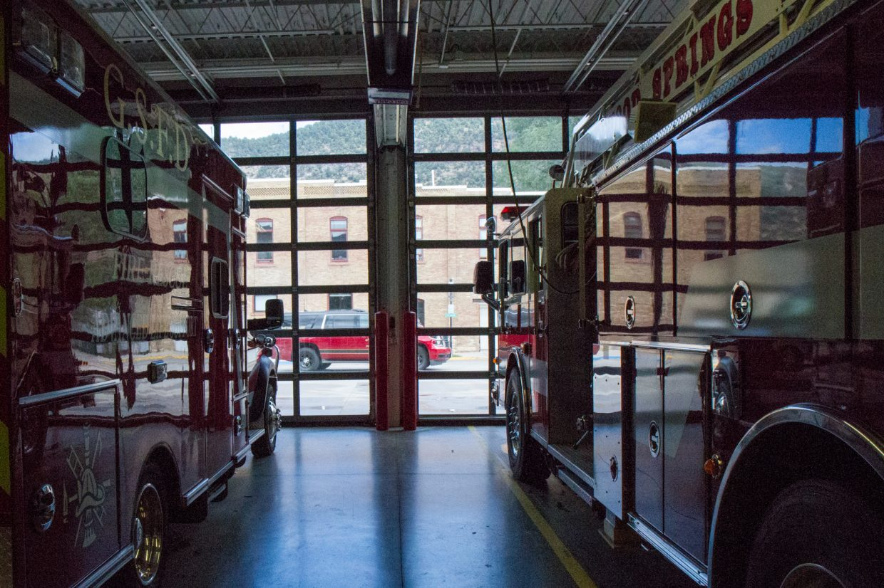 The downtown fire station has one ambulance, one fire engine, and one ladder truck.