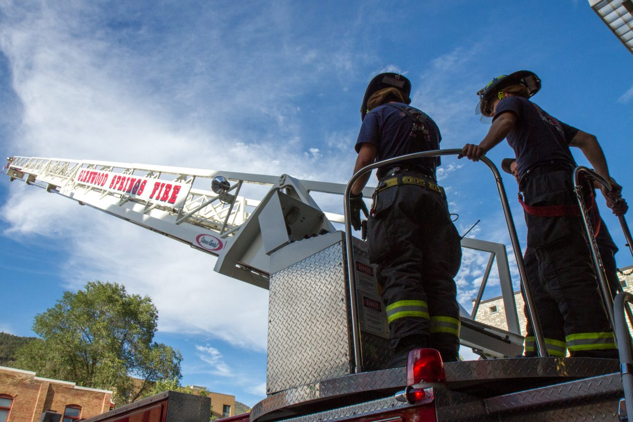 Kevin Carlson and Blake Kerrigan training on the ladder truck at the statoin in downtown Glenwood Springs.