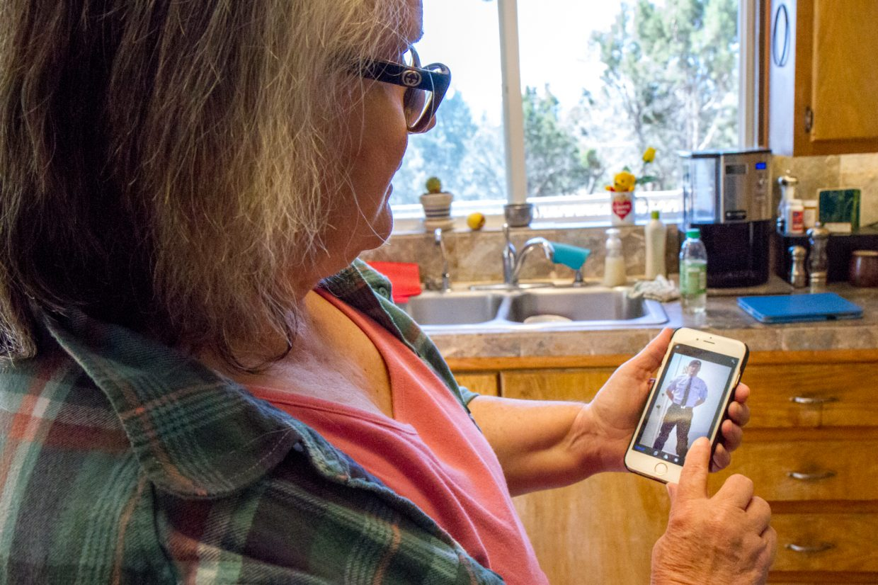 Janet Westhoff looking at a photo of son Adam.