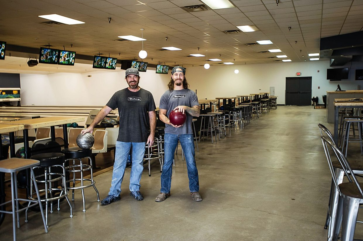 Craig Spivey, left, and Dillon McDermott of Bowlounge are prepared for the grand opening of the bowling alley in El Jebel on Friday. It features 16 bowling lanes 16 televisions playing music videos.