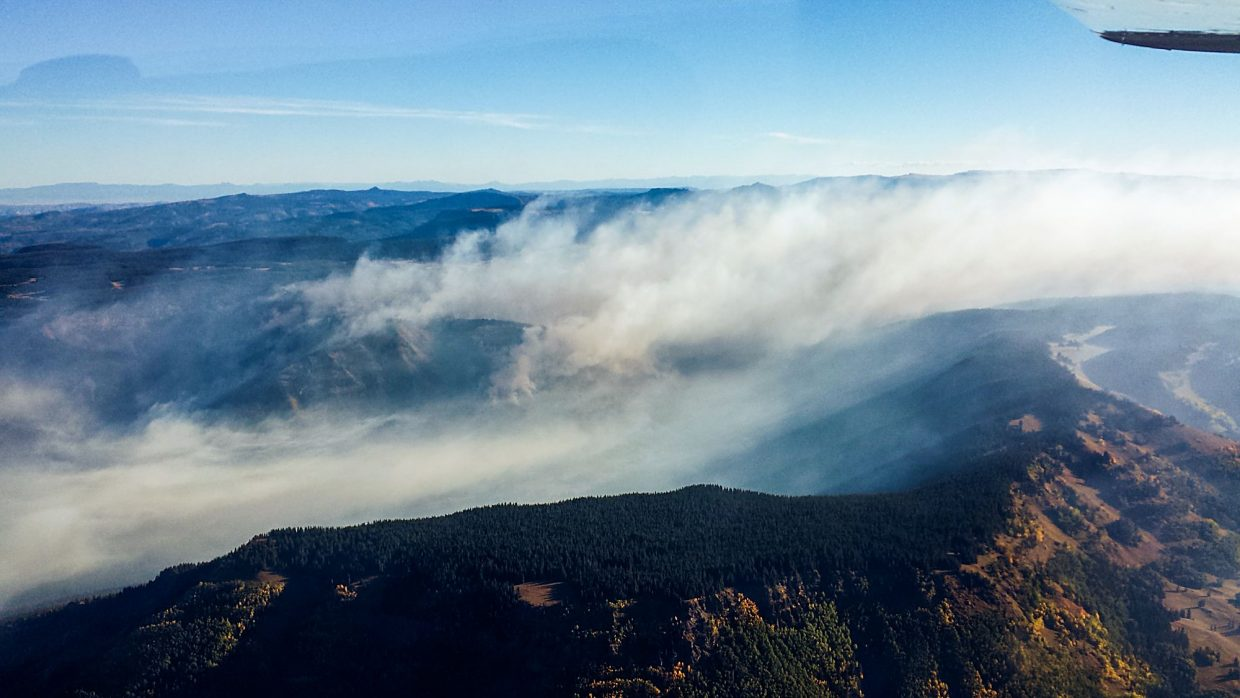 Smoke from the Lost Solar Fire in the Flat Tops Wilderness drifts eastward on Friday morning.