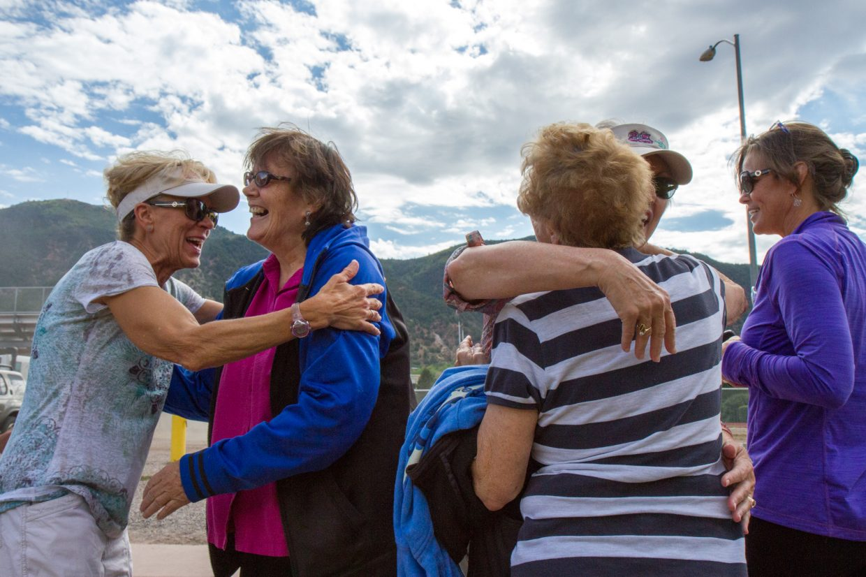 Deborah and Ruth were greeted by members of the Walk and Talk cancer support group after their paragliding adventure Thursday morning.