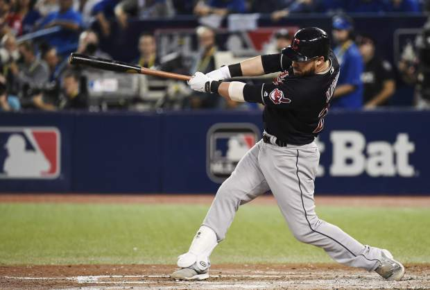 Cleveland Indians' Jason Kipnis (22) hits a solo home run against the Toronto Blue Jays during sixth inning, game three American League Championship Series baseball action in Toronto on Monday, Oct. 17, 2016. (Nathan Denette/The Canadian Press via AP)