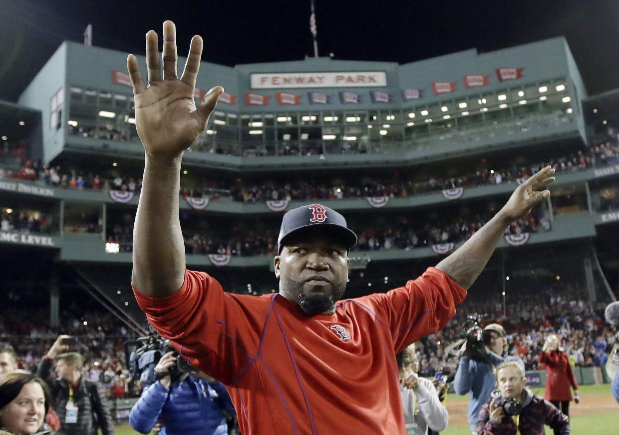 Boston Red Sox's David Ortiz waves from the field at Fenway Park after Game 3 of baseball's American League Division Series against the Cleveland Indians, Monday, Oct. 10, 2016, in Boston. The Indians won 4-3 to sweep the Red Sox in the series. Ortiz said he will retire at the end of the season. (AP Photo/Charles Krupa)